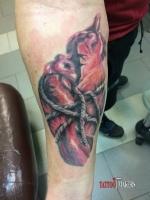 Татуировка сердце, реализм