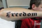 Тату надпись FREEDOM.
