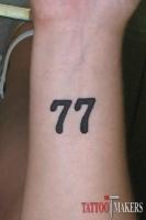 тату на руке две семерки 77